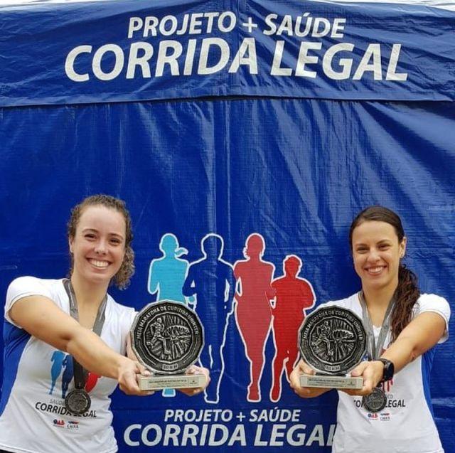 Integrantes da Corrida Legal sobem ao pódio da Meia Maratona de Curitiba